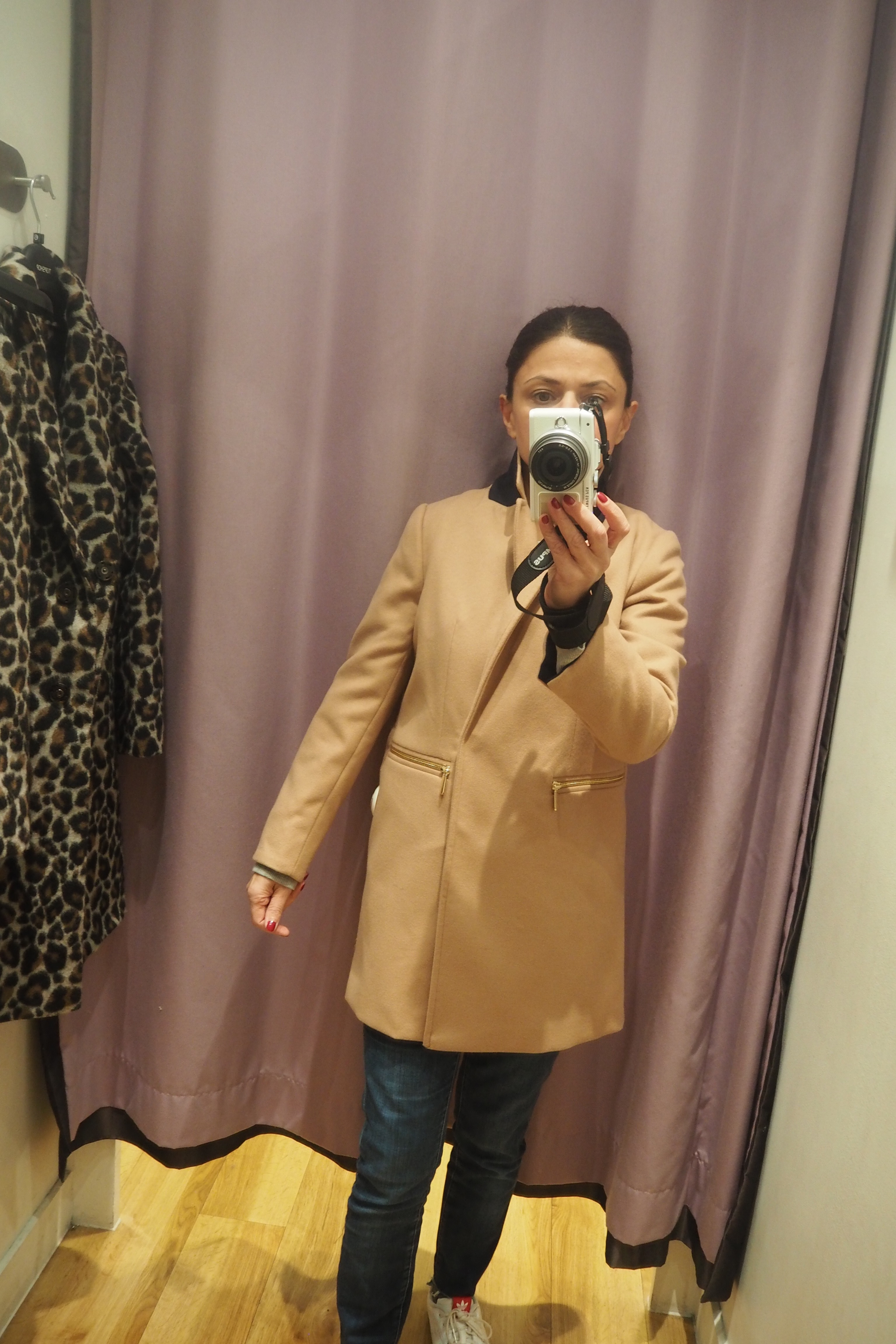 The coat was far too wide across the chest